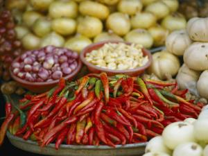 Close View of Chili Peppers and Other Vegetables at a Food Market by Steve Raymer