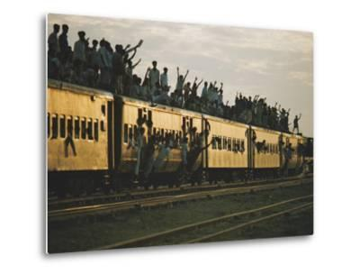 Famine refugees crowd aboard a train bound for the capital, Dacca