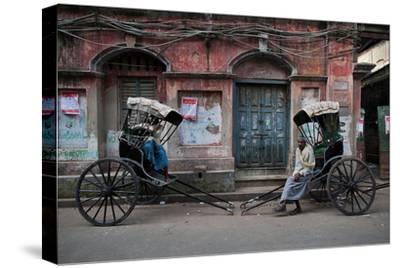 Rickshaw Pullers Pause for a Break on a Kolkata Side Street