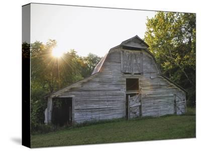 Sun Rises Behind a 100-Year-Old Barn Along Historic Maple Grove Road