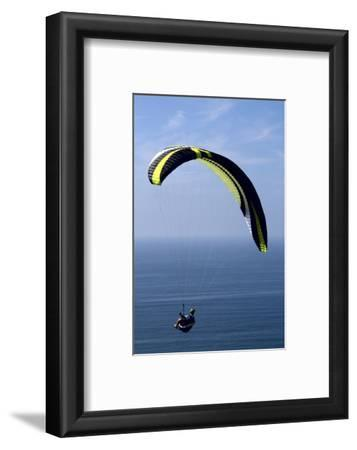 California, San Diego. Hang Glider Flying at Torrey Pines Gliderport