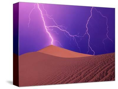 Lightning Bolts Striking Sand Dunes, Death Valley National Park, California, USA