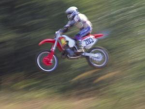 Motocross Racer Airborne by Steve Satushek