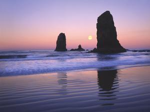 Moonset Between the Needles Rocks in Early Morning Light, Cannon Beach, Oregon, USA by Steve Terrill