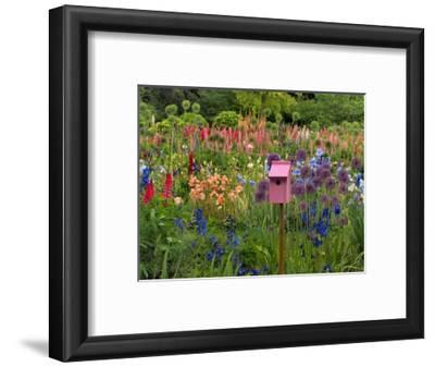 Pink Birdhouse in Flower Garden