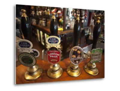 England, London, Beer Pump Handles at the Bar Inside Tradional Pub