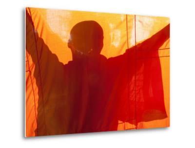 Laos, Vientiane, Monk Hanging Robes
