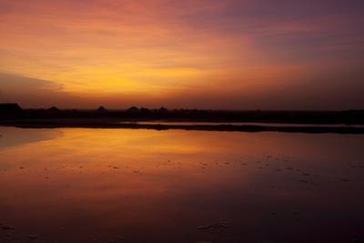 A Glowing Orange Sunset over Sambhar Salt Lake by Steve Winter