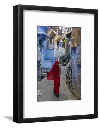 A Woman in a Red Sari Walks Down a Street in Jodhpur's Blue City