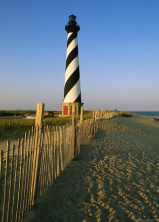 Cape Hatteras Lighthouse with Surrounding Sand Fence by Steve Winter