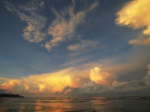 Clouds Glow in the Light of the Setting Sun by Steve Winter