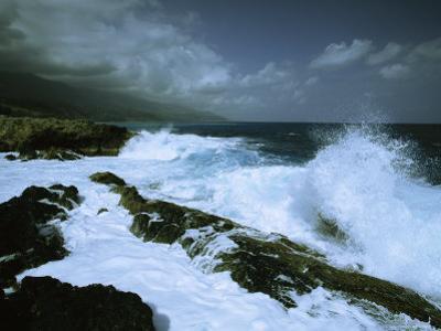 Surf Pounds on One of Cuba's Rocky Coastlines Under a Stormy Sky by Steve Winter