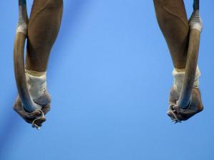 Male Gymnast Competing on Rings in Men's Qualification, 2004 Olympic Summer Games, Athens, Greece, by Steven Sutton
