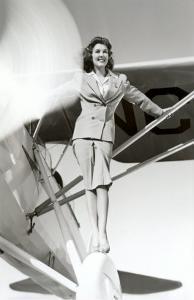 Stewardess Balancing on Plane Wheel