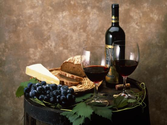 Still Life of Wine Bottle, Wine Glasses, Cheese and Purple Grapes on Top of Barrel--Photographic Print