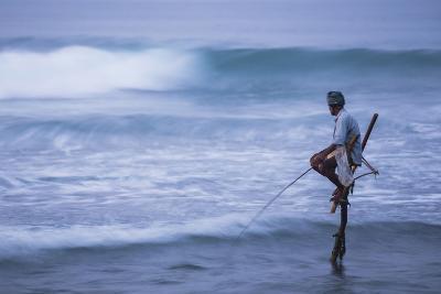 Stilt Fishing, a Stilt Fisherman in the Waves at Midigama Near Weligama, South Coast-Matthew Williams-Ellis-Photographic Print