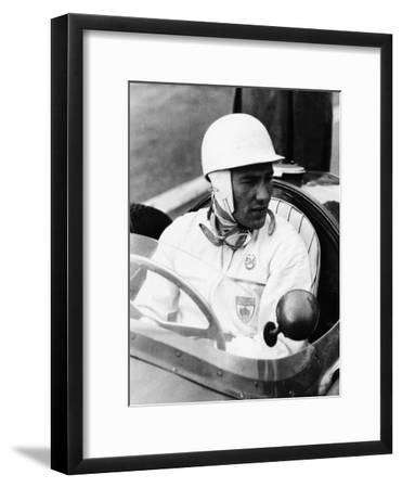 Stirling Moss at Goodwood, 1954
