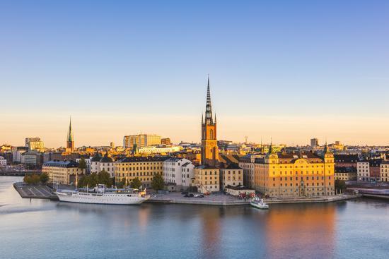 Stockholm, Sweden, Northern Europe. High angle view over Riddarholmen and Riddarholmskyrkan (church-Marco Bottigelli-Photographic Print