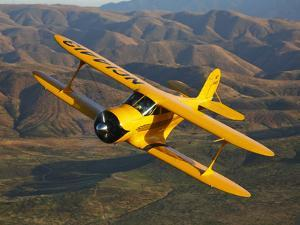 A Beechcraft D-17 Staggerwing in Flight by Stocktrek Images