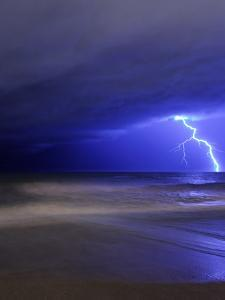A Bolt of Lightning from an Approaching Storm in Miramar, Argentina by Stocktrek Images