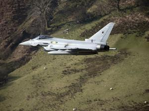 A Eurofighter Typhoon F2 Aircraft of the Royal Air Force Low Flying in North Wales by Stocktrek Images