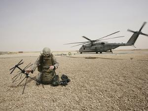 A Field Radio Operator Sets Up Satellite Communication by Stocktrek Images