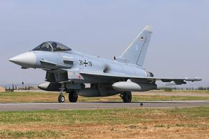 A German Air Force Eurofighter Ef-2000 Taxiing on Runway by Stocktrek Images