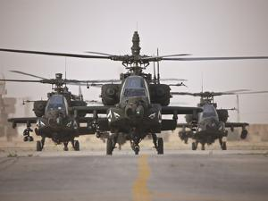 A Group of AH-64D Apache Helicopters On the Runway at COB Speicher by Stocktrek Images