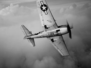 A Grumman F6F Hellcat Fighter Plane in Flight by Stocktrek Images