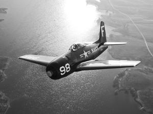 A Grumman F8F Bearcat in Flight by Stocktrek Images