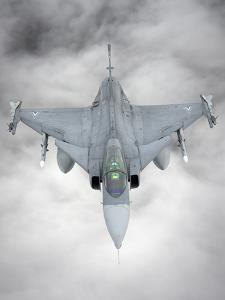 A Hungarian Air Force Jas-39 Gripen over Lithuania by Stocktrek Images