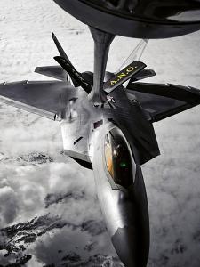 A KC-135 Stratotanker Refuels a F-22 Raptor by Stocktrek Images