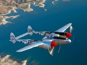 A Lockheed P-38 Lightning Fighter Aircraft in Flight by Stocktrek Images