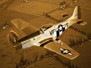 A North American P-51D Mustang in Flight by Stocktrek Images