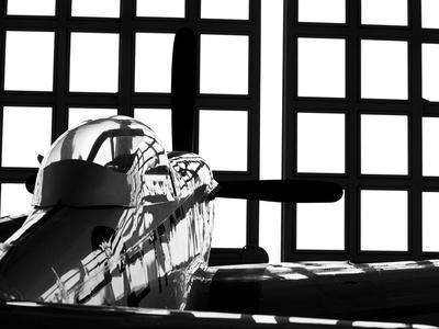 A P-51 Mustang Parked in An Aircraft Hangar