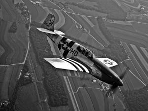 A P-51C Mustang in Flight by Stocktrek Images