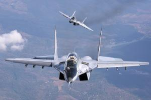 A Pair of Bulgarian Air Force Mig-29S Aircraft over Bulgaria by Stocktrek Images