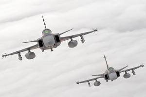 A Pair of Hungarian Air Force Jas-39 Gripen over Lithuania by Stocktrek Images