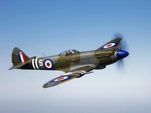 A Supermarine Spitfire MK-18 in Flight by Stocktrek Images