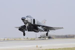 A Turkish Air Force F-4E 2020 Terminator Taking Off from Konya Air Base by Stocktrek Images