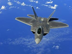 A U.S. Air Force F-22 Raptor in Flight Near Guam by Stocktrek Images