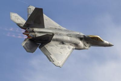 A U.S. Air Force F-22 Raptor Makes a Fast Flyby by Stocktrek Images