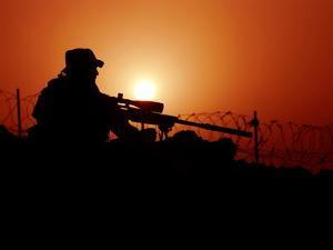 A U.S. Special Forces Soldier Armed with a Mk-12 Sniper Rifle at Sunset by Stocktrek Images