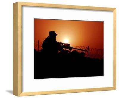 A U.S. Special Forces Soldier Armed with a Mk-12 Sniper Rifle at Sunset
