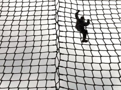A US Army Soldier-In-Training Makes Her Way Down the Rope Ladder at Victory Tower by Stocktrek Images