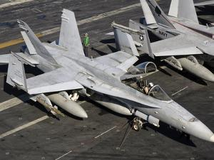 A US Navy F/A-18C Hornet Parked on the Flight Deck of USS Nimitz by Stocktrek Images