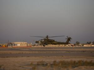 AH-64 Apache Hovering Above the Ramp, Tikrit, Iraq by Stocktrek Images