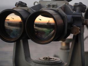 Aircraft Carrier USS Dwight D. Eisenhower Is Reflected in a Set of Big Eyes Binoculars by Stocktrek Images