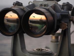 Aircraft Carrier USS Dwight D. Eisenhower Is Reflected in a Set of Big Eyes Binoculars by Stocktrek Images