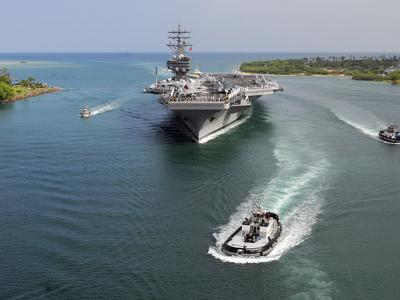 Aircraft Carrier USS Ronald Reagan Transits Pearl Harbor Into Hawaii